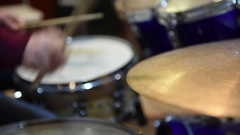 Drummer hand playing on golden cymbal plate Arkistovideo