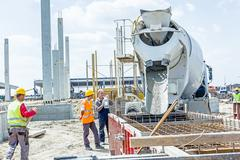 Pouring reinforced concrete in foundation mold Stock Photos
