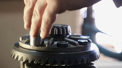 4k, Worker repairing a car reducer, close-up 3 Stock Footage