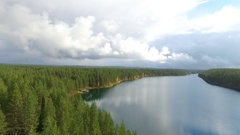 Aerial rising view above the mirroring lake ollori, near hossanjarvi, in Ho.. Stock Footage