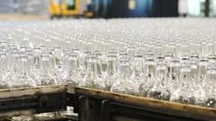 Many bottles on conveyor belt in factory Stock Footage
