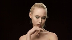 Beauty woman face closeup isolated on black background. Beautiful model girl Stock Footage