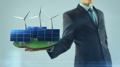 Business man has on hand green energy concept build animation solar panel and Stock Footage