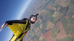Skydiving wing suit woman Stock Footage