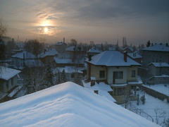 Winter sunrise over houses with snowy roofs Stock Footage