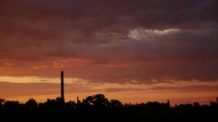 Sunrise Time Lapse Sky and moving clouds Power Plant pipe with smoke Latvia 4K Stock Footage