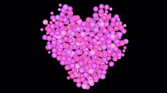 Pink spheres tumble down to form a heart - black background. Stock Footage
