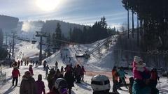 BUKOVEL, UKRAINE - : Skiers near the lift Stock Footage