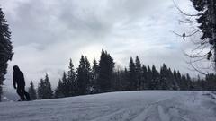 People ride on the track on ski resort Stock Footage