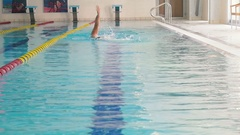 The swimmer swimming backstroke in the swimming pool Stock Footage