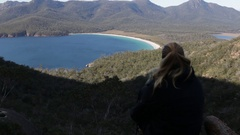 Female above world famous Wineglass Bay Stock Footage