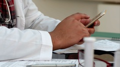 Male doctor hands texting on a smartphone Stock Footage
