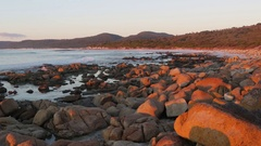 Sunset tints rocks red at Friendly Beaches Stock Footage