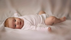 Portrait of four month old baby lying on his back Stock Footage