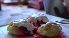 Man using smartphone at breakfast time. Cheese pancakes, minicakes and berry jam Stock Footage
