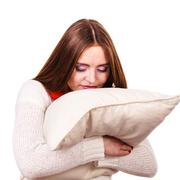 Woman sleepy tired with pillow almost falling asleep Stock Photos