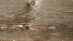 Natural old wood weathered board texture crack lines curves swirls close up Stock Footage