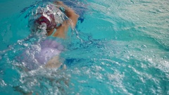 Little girl training to swim crawl in the swimming pool Stock Footage