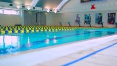Professional sportsman training to swim crawl in the swimming pool Stock Footage