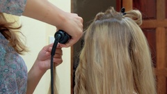Making Hair Style with Curling Iron. Preparation for wedding Stock Footage