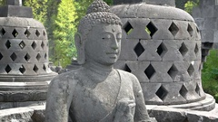 Statue of the Buddha amidst Stupas in Taman Nusa Indonesian Cultural Park Stock Footage