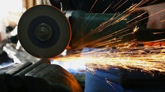 Man sawing a metal pipe with help of angle grinder, slow motion 2 Stock Footage
