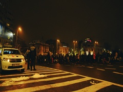 Anti-corruption protesters  march with police man and woman standing by Stock Footage