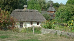 Traditional Ukrainian Architecture with Thatched Roofs and Wooden Shingles Stock Footage