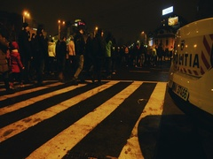 Anti-corruption protesters march with police car in foreground Stock Footage