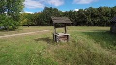 Old Well with Wooden Cover and Hand Crank in Rural Ukraine Stock Footage