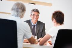 Retired Couple Talking To Their Financial Advisor Stock Photos