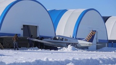 Training sport aircraft to take off on a snow-covered runway. Boat piloting. Stock Footage