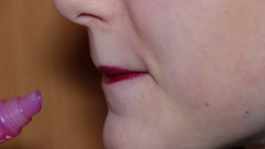 Woman Paints her lips Stock Footage