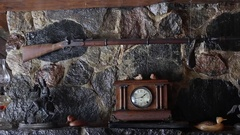 Vintage antique gun hung on fireplace mantle Stock Footage