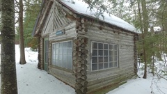 Cabin in the woods winter approach corner 4k Stock Footage