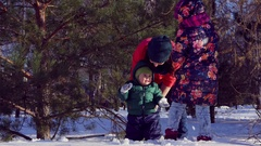 Walk with the children in winter city Park. Mother playing with her daughter and Stock Footage