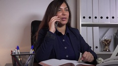 Positive female executive white office interior phone call discussion happy joy Stock Footage