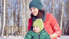 Birch grove in the city Park . A parent a mother with a young son. Stock Footage