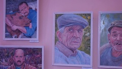 The artworks in the exhibition, portraits of people. Stock Footage
