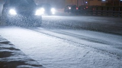 Cars on the city road in a snowstorm. Stock Footage