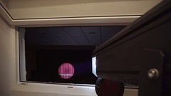 Follow spot shines on the open curtain Stock Footage