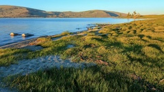 Sunset on the salted lake Khoton Nuur, Mongolia. Full HD Stock Footage