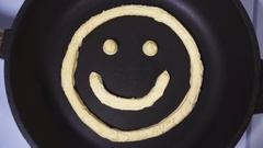 Smiley face made from butter, accelerated video Stock Footage