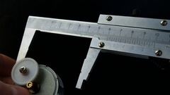 Calipers on black background. The movement of caliper. Closeup Stock Footage