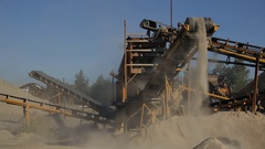 At the plant at high conveyor moves the sand and drops down Stock Footage