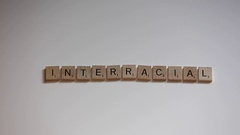 Interracial scrabble letters Stock Footage