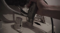 Insert electrical plug in old wall socket Stock Footage