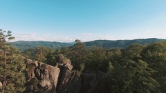 Arial shot flying big forest covered mountains. Stock Footage