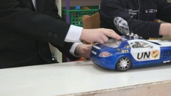Two boys play toy model cars at the table Stock Footage