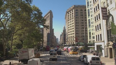 Driving along famous Fifth Avenue toward iconic Flatiron Building in city center Stock Footage